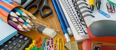 Assorted office supplies, notebooks, pencils