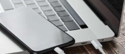 Phone on top of laptop keyboard