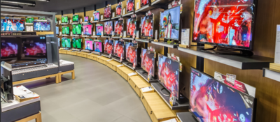 A wall of TVs in an electronics store.