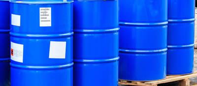 Large blue barrels on plywood boards