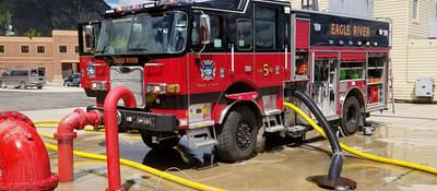 A parked fire truck receiving maintenance.