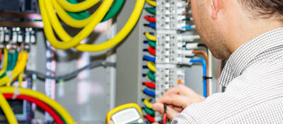 Electrical engineer working in electrical cabinet