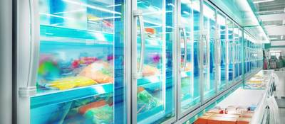 A row of supermarket freezers filled with all types of refrigerated food.