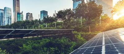 A photo voltaic panel sits to the right of skyline views