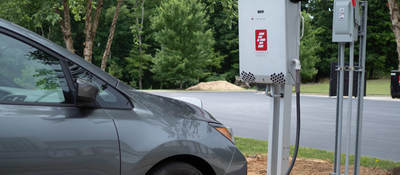 Image of silver electric vehicle and white bidirectional charger
