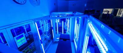 Hospital examination table being treated with UV light for sterilization
