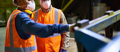 Factory working wearing PPE