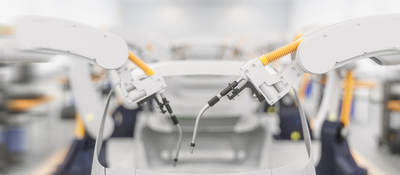 Car being built on assembly line in factory with robot arm adding parts to car