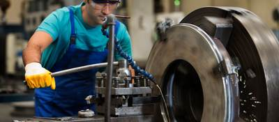 Man using metal cutting machine in factory