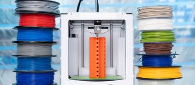 Spools of 3D printing filament and a 3D printer