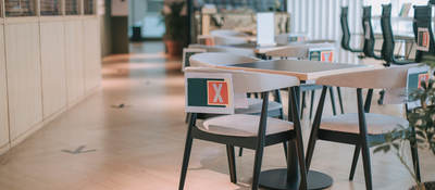 Safe workplace with socially distanced tables