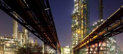 Pipelines at refinery at night