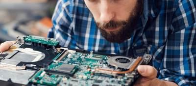 Engineer studying computer motherboard