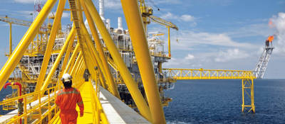 A worker walking on a platform on an offshore oil rig
