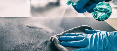 Cleaning table with spray and gloves