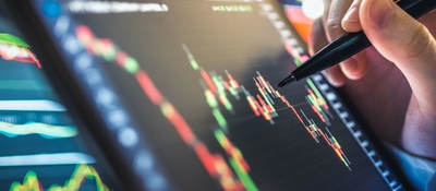 Analysis of stock chart for investment in stock market and finance business planning
