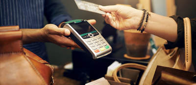woman holding a credit card for payment