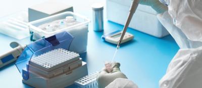 scientist adding fluid test tube