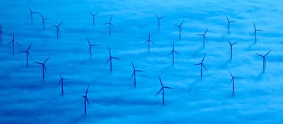 A wind farm in a sea of blue clouds
