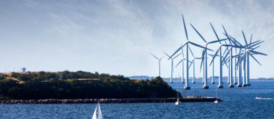 Wind turbines at sea with boat