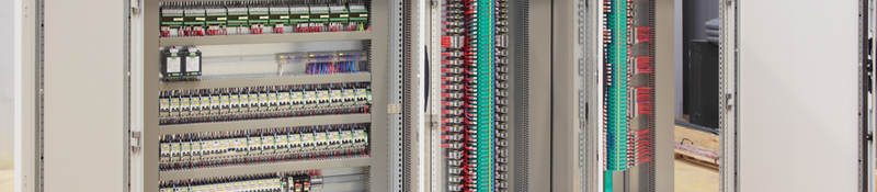 The inside of an industrial control panel board.