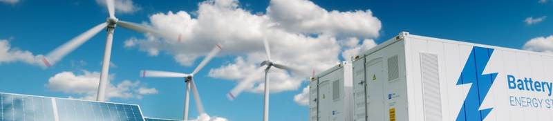 Photovoltaics, wind turbines and Li-ion battery container in fresh nature.