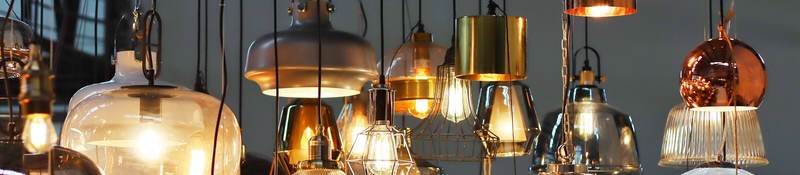 A variety of lights and lamps hanging from ceiling