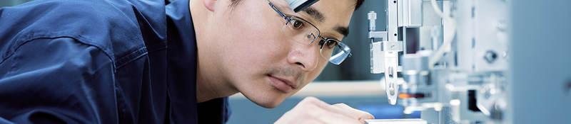 man-looking-through-microscope-in-laboratory
