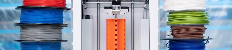 Spools of 3D printing filament and a 3D printer