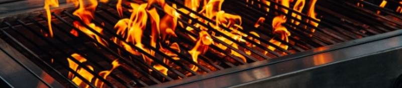 Barbecue gas grill with flames coming up