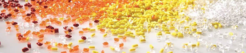 Red, orange and yellow plastic pellets