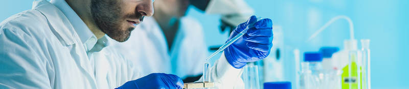 Scientists perform chemical testing in a laboratory