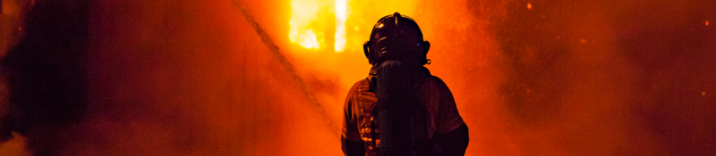 Firefighter and fire at night