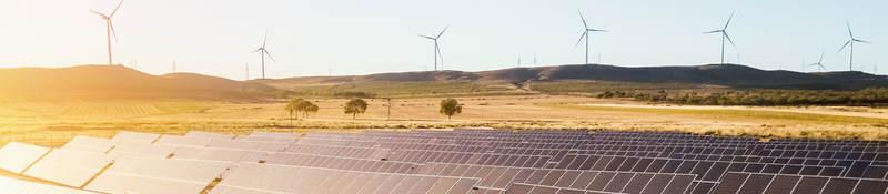 Sunrise on a solar and wind farm