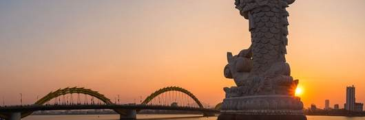 view of the dragon bridge over the water in da nong, vietnam