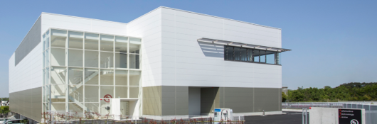 Modern white building with glass front. UL's ATC division in Japan.
