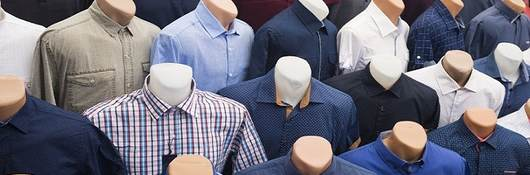 66518597 - the range of men's shirts on mannequins in the market (selective focus)