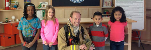 fireman and children in front of safety smart logo