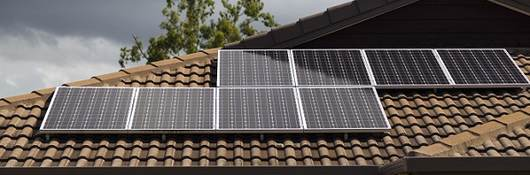 solar photovoltaic panels installed on tiled roof,