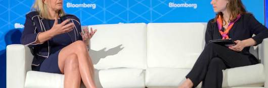 Gitte Schjøtz, president of UL's Software division., discusses sustainability from a white sofa at the Bloomberg Summit