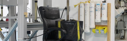 A weight sits on an office chair as part of testing