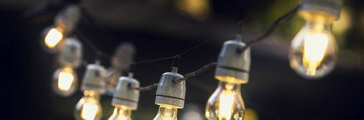 A strand of string lights in an outdoor setting.