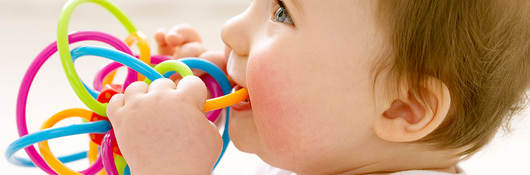 Baby playing with a teething toy