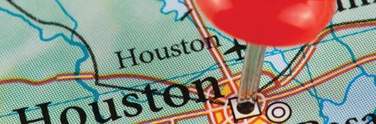 Map with Houston, Texas pinned by a thumb tack
