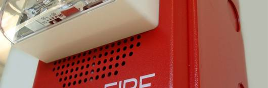 Close-up of fire alarm with speaker and strobe