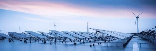Large wind turbines and solar panels