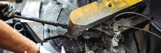 A malfunctioning industrial cutting machine