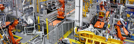 Robot arms in a car manufacturing factory