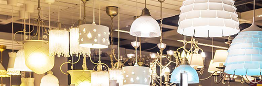 display of lamps hanging from a ceiling