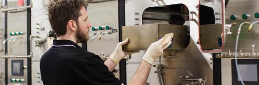 Guy inserting a drawer in chem lab
